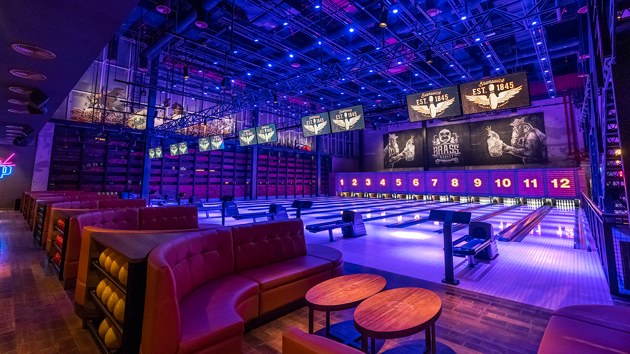 blacklit bowling alley with bowling sofas with built in ball racks